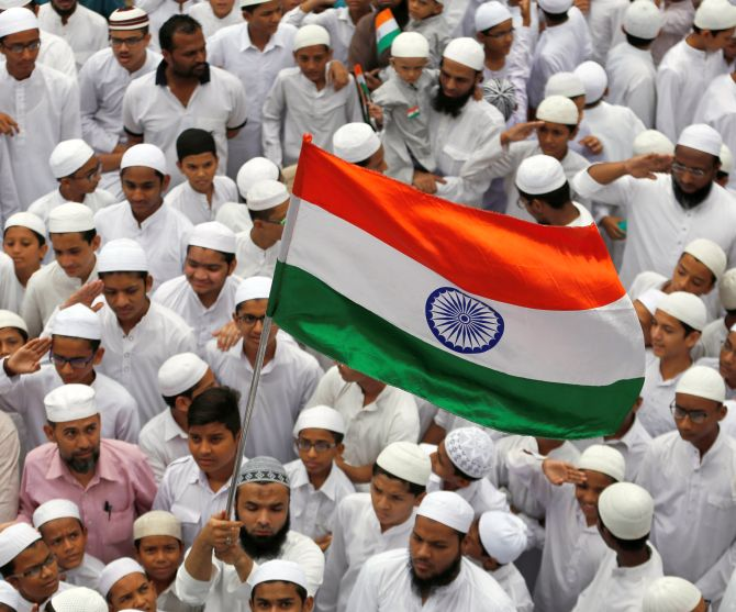 A Muslim man waves an Indian flag during a march to celebrate India's Independence Day in Ahmedabad, India, August 15, 2016. REUTERS/Amit Dave - RTX2KWWX