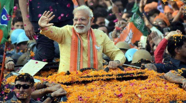 Varanasi: Prime Minister Narendra Modi during his road show in Varanasi on Sunday. PTI Photo(PTI3_5_2017_000222a)